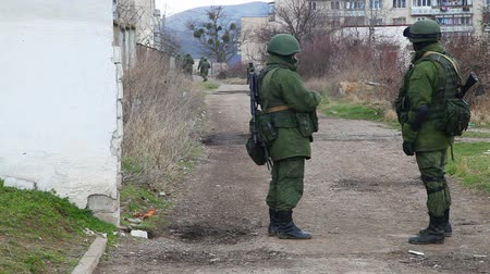 PEREVALNE, UKRAINE - MARCH 4: Russian soldiers guarding a naval base on March  4, 2014 in Perevalne, Crimea, Ukraine. On February 28, 2014 Russian military forces invaded Crimea peninsula.