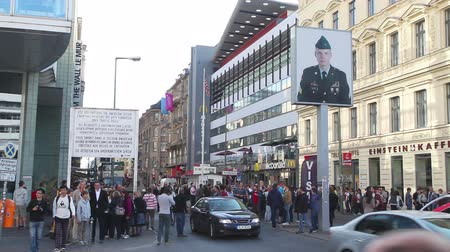 BERLIN - OCTOBER 4, 2014: Checkpoint Charlie on October 4, 2014 in Berlin, Germany. The name was given by the Western Allies to the best-known Berlin Wall crossing point between East and West Berlin during the Cold War.