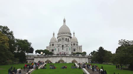 PARIS - OCTOBER 12: Basilica of the Sacred Heart of Paris (Sacre-Coeur) on October 12, 2014 in Paris, France. A popular landmark, the basilica is located at the summit of the butte Montmartre, the highest point in the city.
