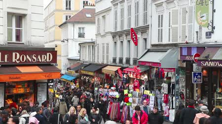 PARIS - OCTOBER 12: Rue de Steinkerque on Montmartre hill crowded with tourists on October 12, 2014 in Paris, France. It is 130 metres high hill in the north of Paris and gives its name to the surrounding district. Stock Footage