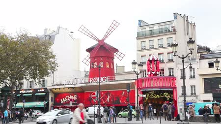 PARIS - OCTOBER 10:  The Moulin Rouge cabaret on October 10, 2014 in Paris, France. Moulin Rouge is best known as the spiritual birthplace of the modern form of the can-can dance.