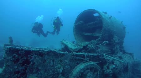 el train : diver inspects locomotive crashed on board the wreck SS Thistlegorm, Red Sea, Sharm el Sheikh, Egypt, Sinai