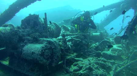 ss : diver inspects the winch mechanism on shipwreck SS Thistlegorm. Red sea, Egypt, Africa