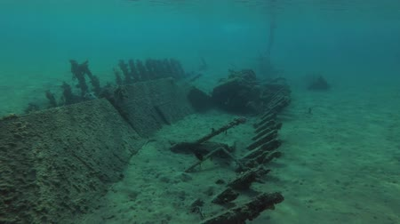 fundo : A wreck, wooden fishing, boat lies in shallow water, on a sandy bottom in the port, Red sea, Egypt