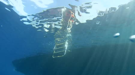 gangplank : Diving boat with a gangway in the water. Indian Ocean, Fuvahmulah island, Maldives, Asia