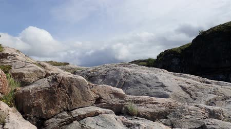 полярный : Clouds over the rocks, mountain landscape. Averoy, Norway. Low-angle shot,