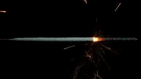 arson : Closeup, Christian sparklers, Bengal lights on black background. Firework sparkler burning on dark background. Stock Footage