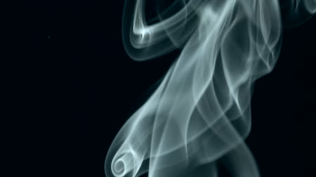 dumanlı : white smoke slowly rising. black background