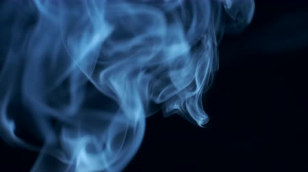 dumanlı : Blue smoke rising to top on black background