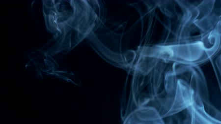 plamen : Blue smoke rising to top on black background