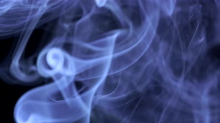 cigarette : Thin trickle of blue smoke. Closeup