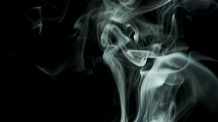 upward : Thin trickle smoke rising graceful twists upward. Cigar smoke blowing from bottom to top. Natural color tobacco smoke, 4k - 60fps Stock Footage