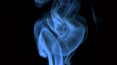 jedovatý : blue smoke, isolated on black background. Closeup.