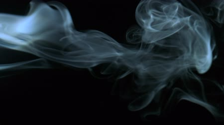 büyülü : Vertical video screensaver. Cold blue smoke isolated on black background, closeup