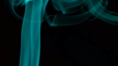 venenoso : turquoise smoke slowly rising to top. Closeup