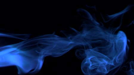 viraj : Vertical video screensaver - Thin trickle neon-blue smoke slowly rising graceful twists upward. Colored smoke blowing from the left side. Closeup, isolated on black background. Stok Video