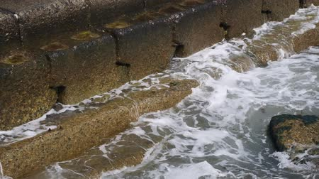 pier : Surf wave crashes against concrete shore reinforcement, Close-up, Full HD - 60fps