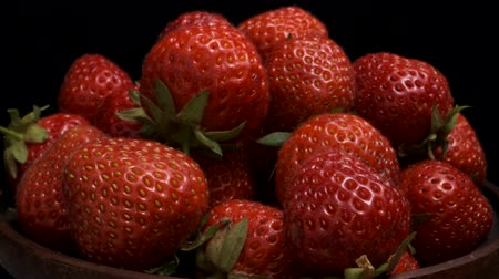 fruity garden : Slow Motion - Fresh Strawberries Camera rotation 360 degrees, closeup. Stock Footage
