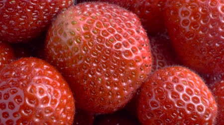 fruity garden : Rotation of juicy ripe strawberries. Top view, Rotation 360 degrees, Extreme close up. 4K - 50fps Stock Footage