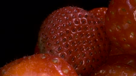 fruity garden : Rotate of red strawberries on black background. Close-up, Camera rotation 360 degrees.