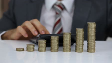 Midsection Of Businessman Protecting The Calculated Rising Coins Stack Stock Footage