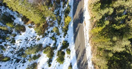 Birds Eye View Of Car Riding On Road Surrounded By Snow Covered Landscape 4K Stock Footage