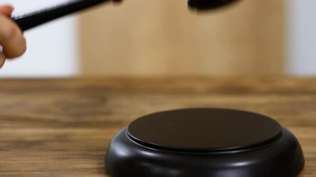 Close-up Of A Judge Hitting Gavel On Mallet In Courtroom