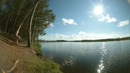 arejado : Boy jumping into the lake.Fisheye.