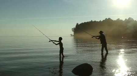 truta : Father and son fishing on the lake.