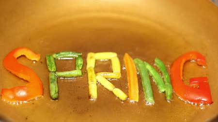 brócolis : In a frying Pan In Boiling Oil Fried Diet of the Word SPRING .In vegetarian cuisine.Multi-colored vegetables.