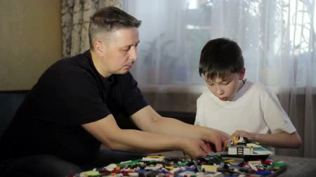 lego : Father and son play LEGO. To work with children.The relationship of father and child.Educational games .