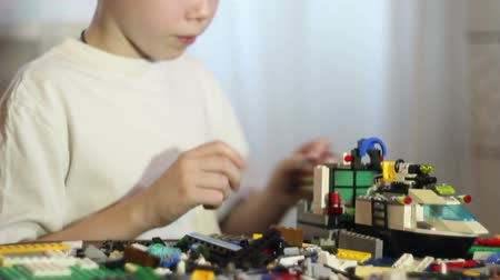 lego : A boy playing in a childrens designer.Educational games .