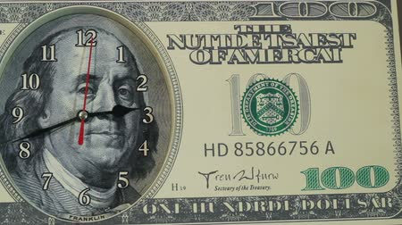 oran : The clock on the hundred dollar bill.