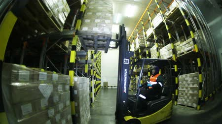 forklift : Loader in the warehouse transports the goods.