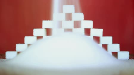 cukorbaj : White sugar on a red background.