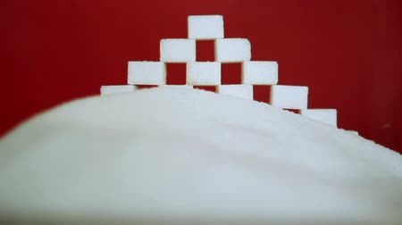 fructose : White sugar on a red background.