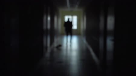 rescue : Silhouette of a man runs through the dark corridor. Stock Footage