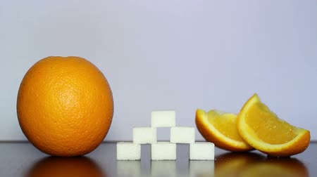 fructose : Orange and white sugar. Stock Footage