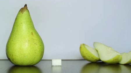 césar : Green pear and white sugar. Stock Footage