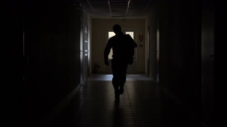 sertés : Slow motion. Silhouette of a man runs through the dark corridor. Dismissal.The Ghost of a businessman .