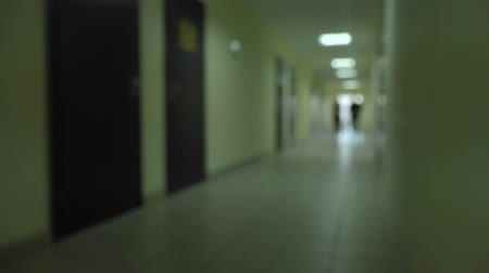 resentment : Silhouette of a man runs through the dark corridor. Stock Footage