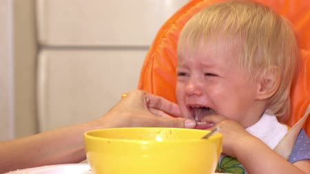 bitter : Baby cries during feeding. Stock Footage