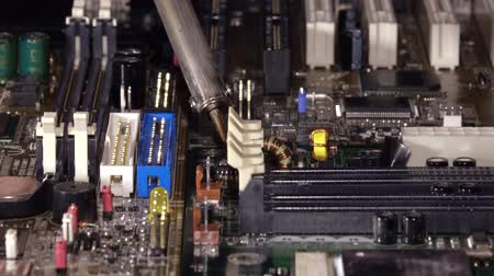 componentes : Soldering to a circuit Board of a computer close up.