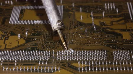 полупроводник : Soldering to a circuit Board of a computer close up.