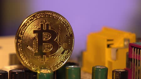 kolaps : Cryptocurrency bitcoin gold. Bitcoins on the motherboard.