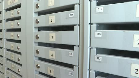 schránky : Mailbox. a lot of grey boxes for mail.