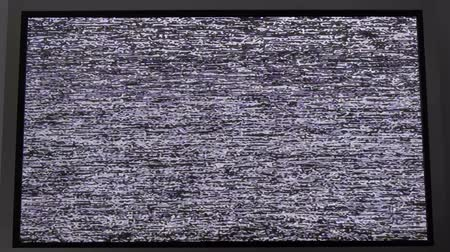 ntsc : Noise signal on the screen.Flickering analog TV signal with bad interference.