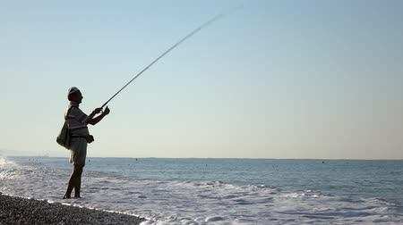 fisher : Fisherman fishing on the sea coast. Stock Footage
