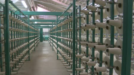 serpentina : Industrial textile factory. Coils with threads in production Stock Footage