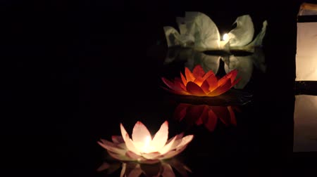 hímzés : Festival of lanterns on the water. Water lantern in the shape of a Lotus with a candle flame floating at night on the water.